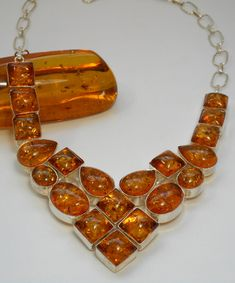 Twenty brilliant highly-polished translucent Amber gemstones adorn this handmade necklace, set in 925-hallmarked sterling silver.