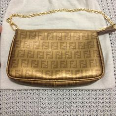 Authentic Fendi Coated Canvas Clutch Gold canvas clutch perfect for a night out! The size is perfect fit and easy to carry on your shoulders! I've taken really good care of this bag! It looks brand new! Willing to lower with ️️ Fendi Bags Clutches & Wristlets