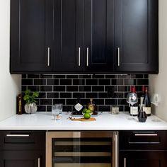 X's pick: black subway tile backsplash,white grout (I like light cabinets though)