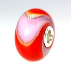 We are now offering the limited edition Armadillos and Daydream Blossom under our Twist section which means you get the bead you see! Red and Lavender Armadillo With A Twist:01, $31.00 (http://www.trollbeadsgallery.com/red-and-lavender-armadillo-with-a-twist-01/)