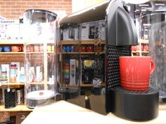 The Nespresso U with a Le Creuset espresso cup.