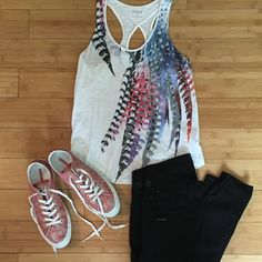 """⬇️REDUCED❗️Express Burnout Tank This tank is white with multicolored feather print on front. There are also sequins within the print. Back has cross back. Burnout style, so it looks worn and washed. Slightly shorter on sides. Worn a few times and in excellent condition. Approximately 14"""" across the bust when laid flat. Approximately 22"""" from shoulder to hem at shortest length and 24"""" at longest. 60% cotton, 40% modal Express Tops Tank Tops"""