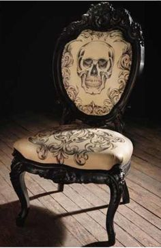 Reupholstered Victorian chair in crossbones my style!