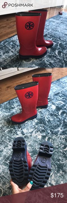 Tory burch red and navy blue rain boots Tory burch size 8 red and navy blue rain boots. Worn only 3-4 times. Great for Spring showers. Small white make on right boot (see photo). Tory Burch Shoes Winter & Rain Boots