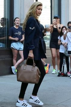 Gigi Hadid wearing Marc Jacobs Incognito Bag and Adidas Originals Superstar Sneakers