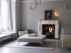Like color scheme, curtains, molding, fireplace with modern furniture.