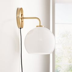 Sale ends soon. Shop Arren Brass Wall Sconce with Milk Round Shade. Bending gracefully from the wall, an iron base supports a sleek glass shade for a chic sconce at once modern and timeless. Plug In Wall Sconce, Black Wall Sconce, Brass Sconce, Modern Wall Sconces, Candle Sconces, Nate Berkus, Hans Wegner, Kelly Wearstler, Sconces Living Room