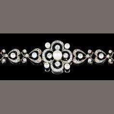 A belle époque pearl and diamond bracelet/brooch,