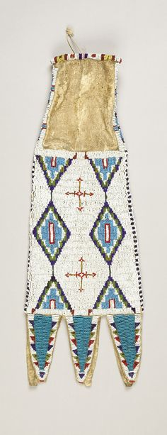 A SIOUX BEADED HIDE TOBACCO BAG. c. 1890... American Indian | Lot #77260 | Heritage Auctions