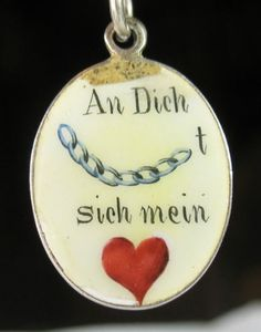 """German enameled rebus charm literally translates to, """"To you…chained…is my heart"""" perhaps meaning """"Two lives, two hearts ...joined together…in friendship…united forever in love."""""""
