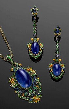 A sapphire, Demantoid, Garnet and Enamel Suite, Attributed to Louis Comfort Tiffany & Co., circa 1920.