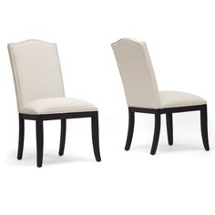 Enhance the mood in your dining space with an element of simple regality. The Tyndall designer dining chair is made with a wooden frame, foam cushioning, beige linen seating and its trademark lovely silver upholstery tack border.