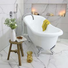 Jess' beautiful white clawfoot bath with a freestanding bath spout