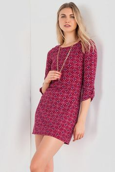"""This simple fall dress is so easy to wear! A pretty medallion pattern decorates this simple shift sweater dress finished with tab sleeves. Finish off your look with a pair of booties & pendant necklace.<br /> <br /> - 34"""" length from shoulder to hem<br /> - 34"""" chest<br /> - 42"""" sweep<br /> - measured from a size small<br /> <br /> - 97% Polyester, 3% Spandex<br /> - Hand Wash<br /> - Made in U.S.A.<br />"""