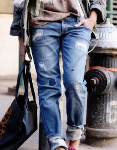 The tattered bf jeans.
