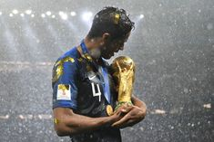 France's defender Raphael Varane holds the World Cup trophy after winning the Russia 2018 World Cup final football match between France and Croatia at the Luzhniki Stadium in Moscow on July Get premium, high resolution news photos at Getty Images World Cup Russia 2018, World Cup 2018, Fifa World Cup, Ballon D'or, Antoine Griezmann, Football Match, Football Team, Football Stuff, France National Team