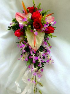 Tropical destination wedding bouquet styled with with orchids, anthuriums and ginger lilies.