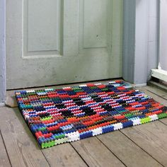 Greet your guests in eco-friendly style before you even open the front door. This doormat has been artfully crafted from recycled flip-flops...