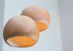 A classic and refined, simple and sophisticated pendant lamp. The Wind lampshade is a flexible, domed structure, made of a sequence of veneer strips resting on each other, closing a circle. This hanging lamp can be used as a single center piece in the living room, it looks great as a pair or