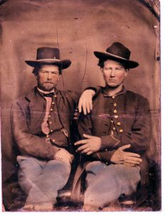 Robert Dotson and Buffalo Bill Cody.   This scan is of an old tintype photo that was in a family collection.  According to family stories the clean-shaven  gentleman on the right is Robert B.  Dotson (b. 1840 Crawford County, MO; d.1903 Crawford County, MO;  served in the Civil War in the Kansas Infantry for the Union side),  and the gentleman on the left with the beard is Buffalo Bill Cody (who  also served in the Kansas infantry during the civil war.
