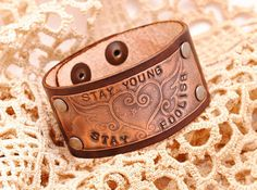 RESERVED FOR NICOLE Etched Copper Stay Young Bracelet Cuff Chocolate mxs Leather via Etsy