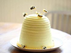 Beehive Cake - Under hovering marzipan bees are layers of banana cake, pecans and honey-scented buttercream in this playful summer cake