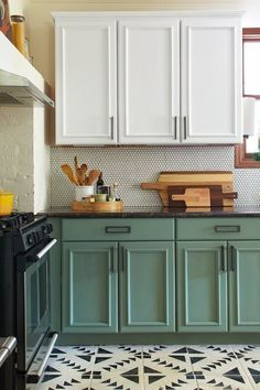 Kitchen Cabinets painted with Chalk Paint®️️ by Annie Sloan   Jessica from The Ktchn used Pure White for the top cabinets and a 50/50 mix of Provence and Chateau Grey for the bottom. The floor is also painted and stenciled with Chalk Paint®️️ by Annie Sloan.