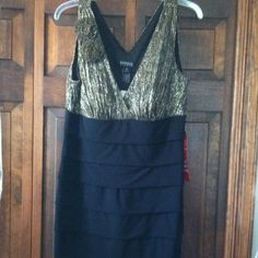 Black and gold bandage dress. REDUCED Body Con sexy black dress with floral decoration on one shoulder. Gold v-neck Dresses