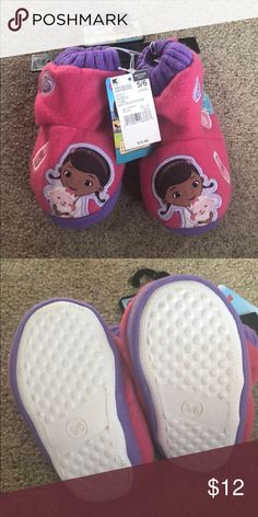 Doc McStuffins Slippers - NEW Doc McStuffins Slippers - New w/ tags but are slightly dirty on bottom from the store. Little girl/toddler size. Disney Shoes Slippers