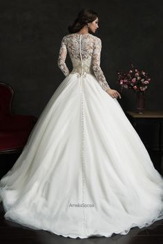Amelia Sposa- Leonor...absolutely love the sleeves, lace, and buttons down the whole back!!