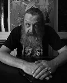"""Alan Moore (born 18 November 1953) is an English writer known for his work in comic books(Watchmen, V for Vendetta etc.) & frequently described as the best graphic novel writer in history.He also worked on major characters such as Batman and Superman ,substantially developed the character Swamp Thing.He is also a ceremonial magician & politically identifies as an anarchist.In 2005, Watchmen was the only graphic novel to make it onto Time's """"All-Time 100 Novels"""" list."""