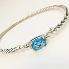 David Yurman Petite Wheaton Blue Topaz Bracelet AUTHENTIC. Sterling silver. Faceted Hampton blue topaz. 9 x 7mm Pavé diamonds, 0.06 total carat weight. Cable 3mm wide. Hook clasp. Beautiful, elegant, & dainty! Like new condition. Open to reasonable offers! David Yurman Jewelry Bracelets