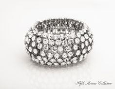 Who's that Lady thick, expansion, cuff bracelet shines with hundreds of Swarovski crystals. go to http://www.fifthavenuecollection.com/public/en-au/acentofanti    click on Jewellary