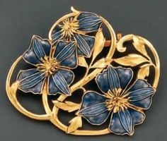 Lalique Brooch Pensees 4.4 by 4 centimeters gold framing supporting three pansies in blue and mauve translucent enamel Lalique Brooch