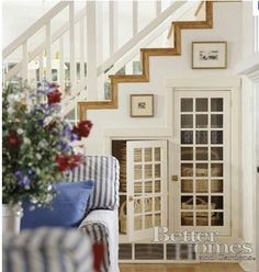 Charming under stair storage, GREAT idea and it looks so nice