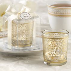Add a golden touch to your special day with these golden renaissance glass tea light holder favors. They come in an adorable gift box with a ribbon and bow! Candle Wedding Favors, Candle Favors, Unique Wedding Favors, Unique Weddings, Wedding Ideas, Wedding Centerpieces, Wedding Decorations, Glass Tea Light Holders, Candle Holders