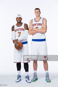 Carmelo Anthony #7 and Kristaps Porzingis #6 of the New York Knicks pose for a portrait at Media Day at the MSG Training Facility in Greenburgh, New York on September 28, 2015.