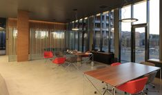 A modern office featuring B&T Absolute Tables, Red Task Chairs and Red Swivel Chairs. Commercial grade.