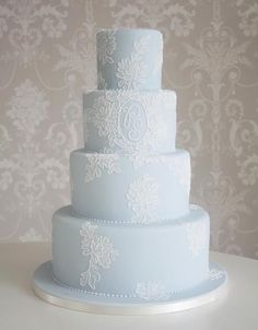 Pale blue tiered wedding cake with beautiful iced detail #weddingcakes