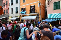 Christening Benediga in Vernazza Traditional candy shower to bless a new born child