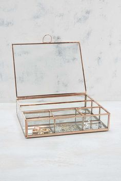 Glass & Copper Jewellery Box by #UrbanOutfitters. Elegant jewellery box crafted from clear glass with metal trimmings is divided into various sections to keep everything neatly organized. Perfect for displaying your jewels while topping a dresser or shelf.