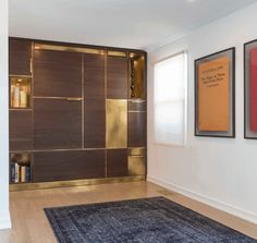 Amuneal Manufacturing Custom Murphy Bed in action shown in silvered walnut and solid brass.
