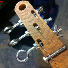 The machine heads I stumbled across at a junk store turned out to be different lengths so I adjusted fire on the  tuners
