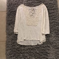 White lace quarter sleeve Worn only a few times. With lace on the chest with a tie (see picture) willing to negotiate price! American Eagle Outfitters Tops Blouses