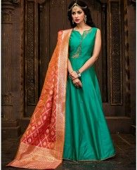 1. Sea Green silk anarkali suit 2. Adorned with jeweled toned patch work 3. Comes with a matching shantoon bottom and silk dupatta 4. Can be stitched upto bust size 42 inches and top length 50 inches