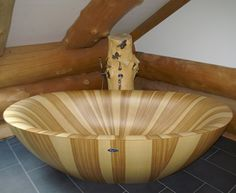 Modern Wooden Bathtub. It's interesting.. and looks smooth and comfortable.