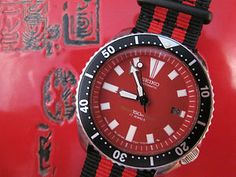 A festive retro red Seiko diver w/matching NATO Strap, just in time for the holidays - up for auction @ DC Vintage