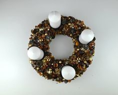 Bring the holiday spirit and joy to your home! This beautiful advent wreath is a great decoration for your Christmas table. It has 4 candles, which means one candle to burn per 1 Advent week. Made from: hay base, pine cones, decor elements, dried flowers and pods, nuts, acorns, moss, beads,