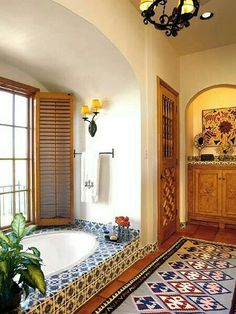Ann... I like this bold tile. Maybe on floor as tile rug and on one wall on the shower or shower floor? With a antique wood buffet turned vanity with a cool sink. For rest of floor a solid complimentary tile.