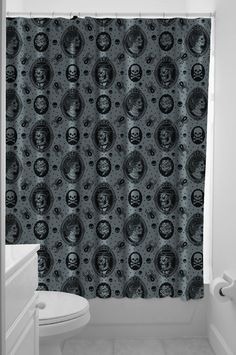 SOURPUSS ZOMBIE CAMEO SHOWER CURTAIN Victorian kitsch & zombies! This perfect mix is featured on this morbidly amazing shower curtain complete with dapper zombified gents, ghoulish ladies, spiders, skulls & more. Includes plastic hanging hooks. $19.00